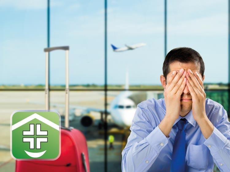 Uomo in aereoporto con mal di denti